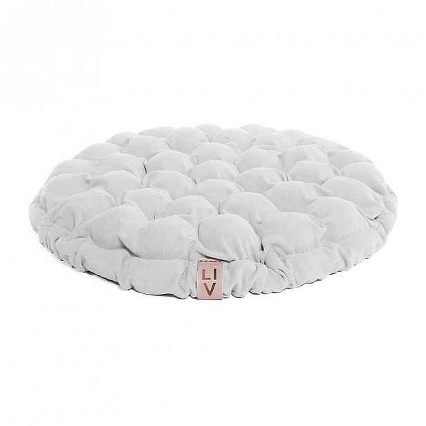 Bílý sedací polštářek s masážními míčky